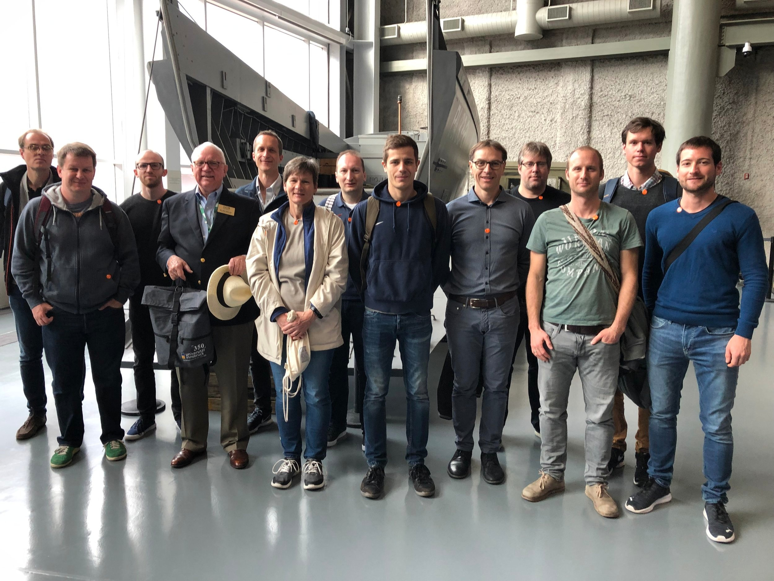 "The group at the National World War II Museum with founding president Gordon ""Nick"" Mueller (4th from left)"