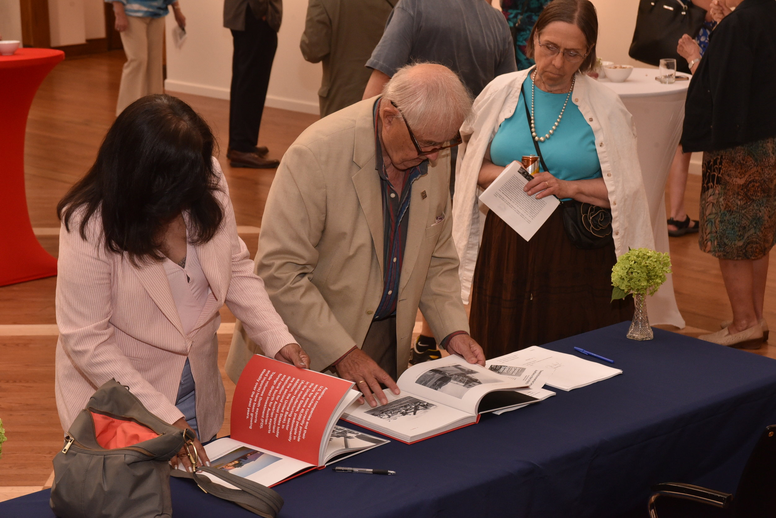Guests view the book.   Photo: Peter Alunans