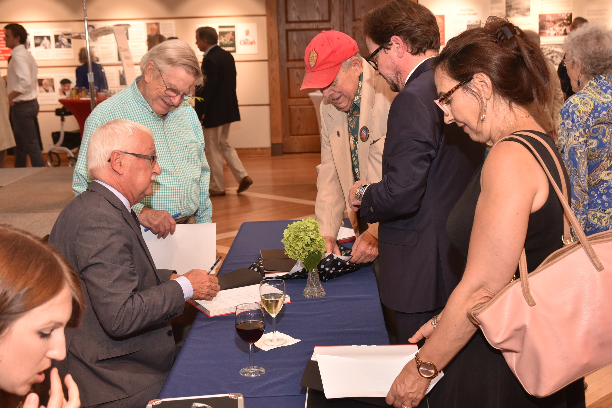 Professor Bischof signs books for guests.   Photo: Lenore Boulet