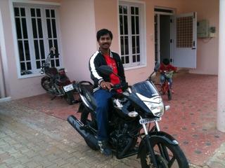 jayaraj on his bike in front of ravi's house