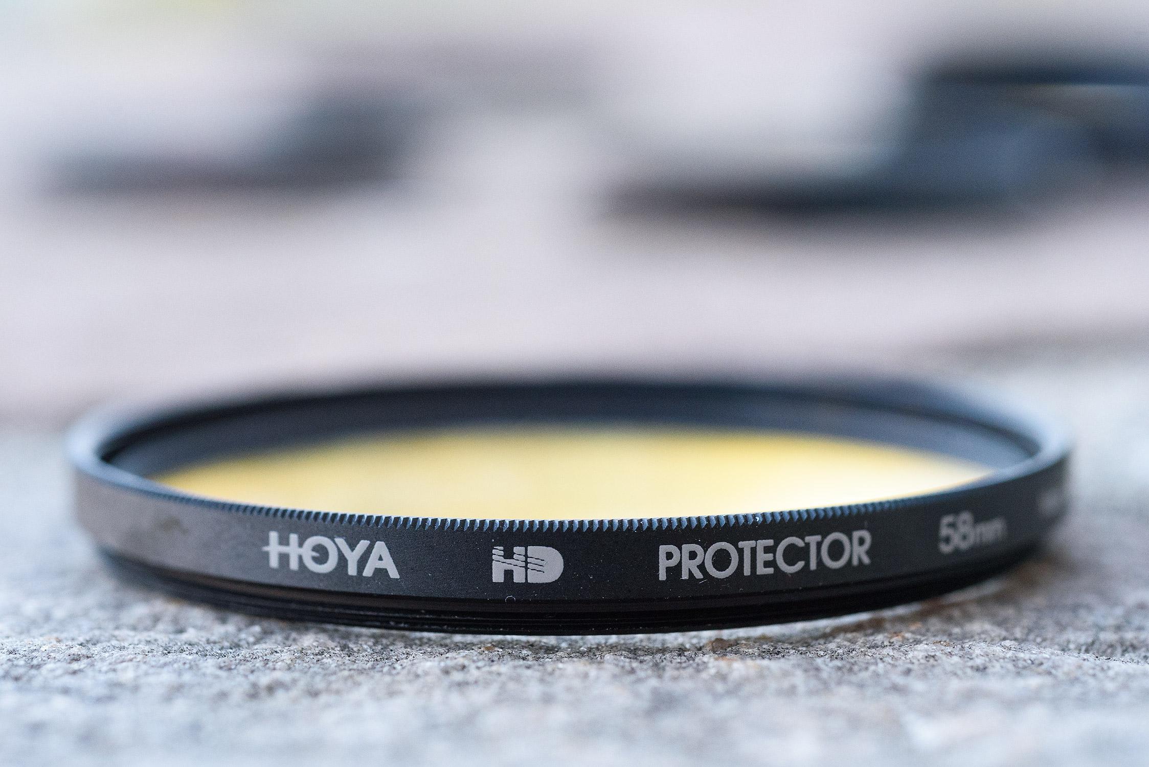 Counterfeit Hoya HD. Matte finish, no chamfered edge.