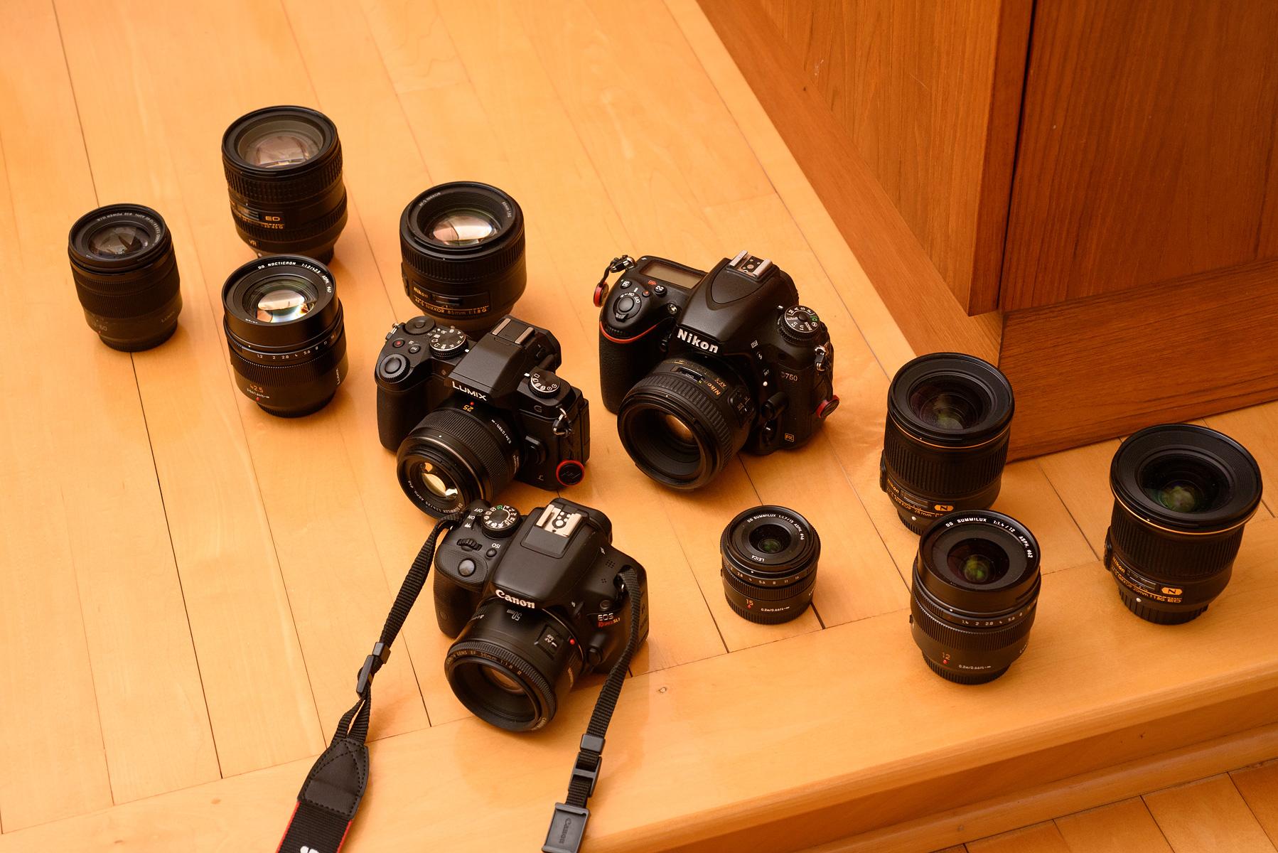 The cumbersome Rebel SL1, the g85, my fullframe Nikon. Dat badass Leica 42.5mm f/1.2 nocticron