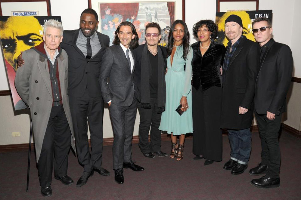 (L-R) Adam Clayton, Idris Elba, Justin Chadwick, Bono, Naomie Harris, Zenani Mandela, The Edge, and Larry Mullen, Jr. at the Ziegfeld Theatre in New York  City / Bryan Bedder/Getty Images (p)