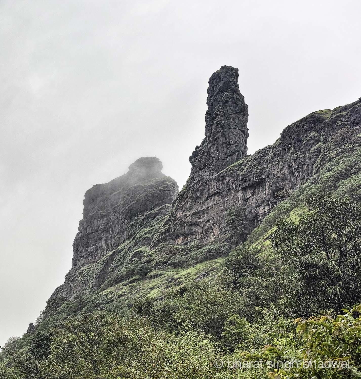 Irshalgad pinnacle draped in clouds