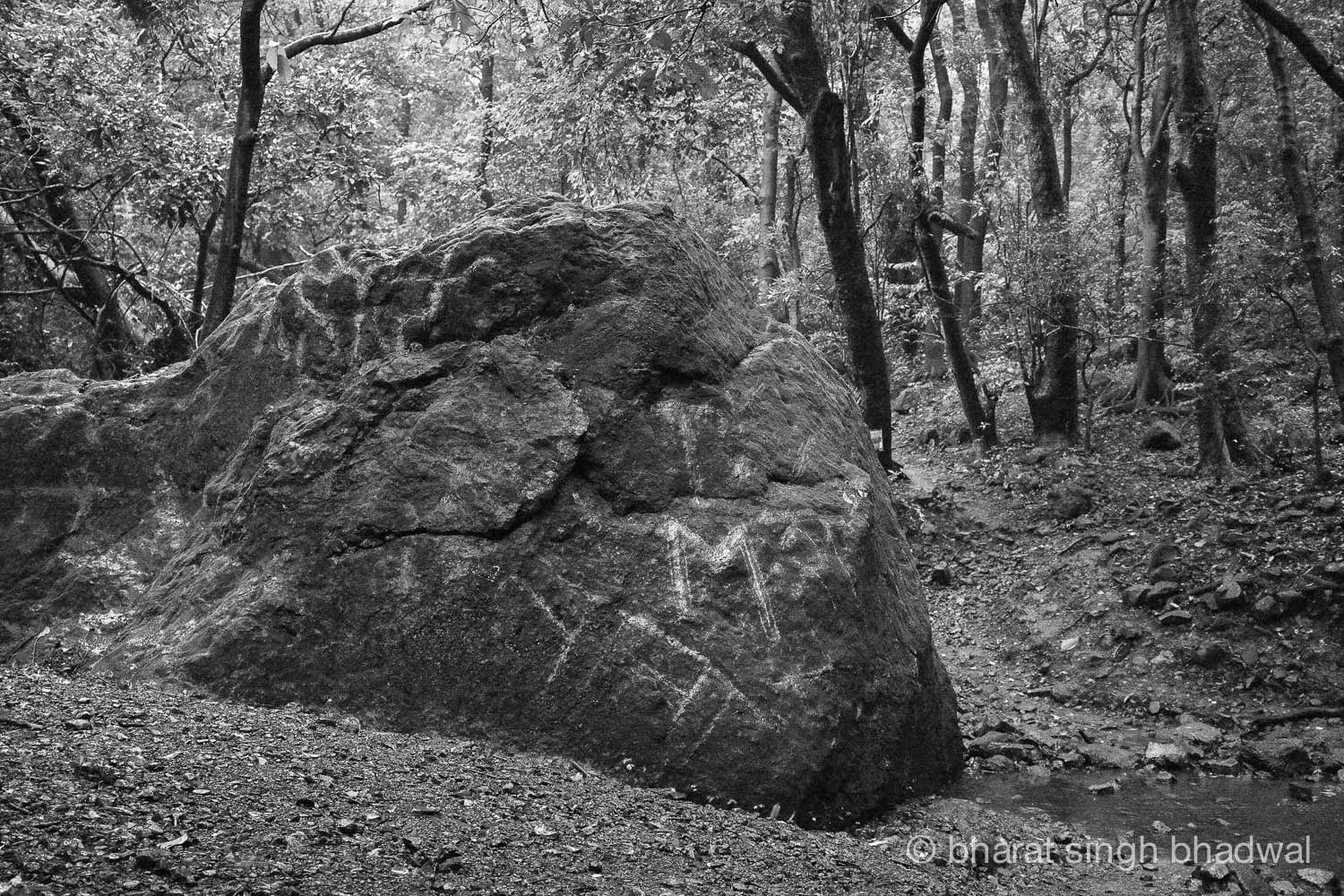 A large boulder along Ganesh Ghat route that has been vandalised.