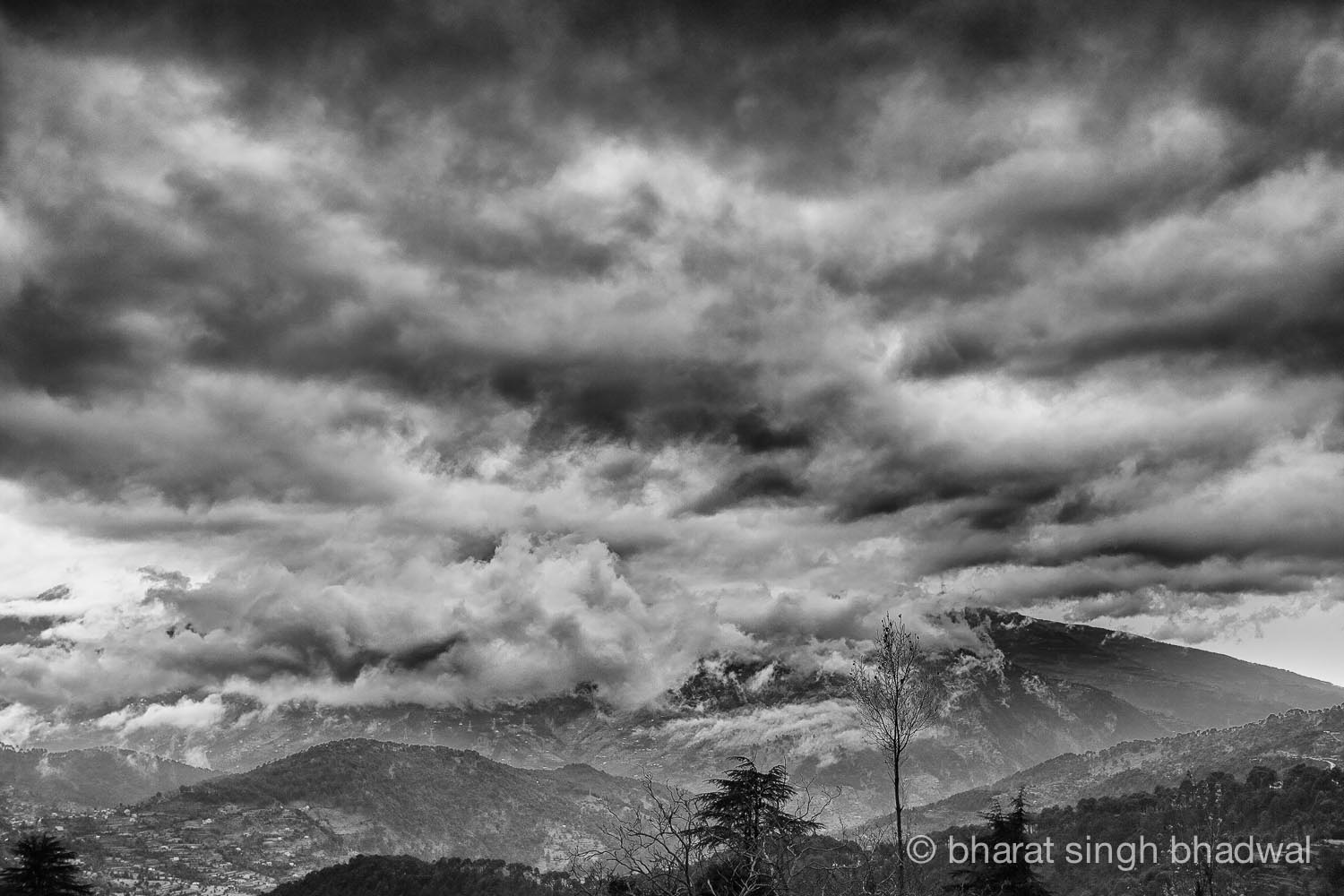 Dark cumulous clouds over Shivalik range, Indian Himalayas.