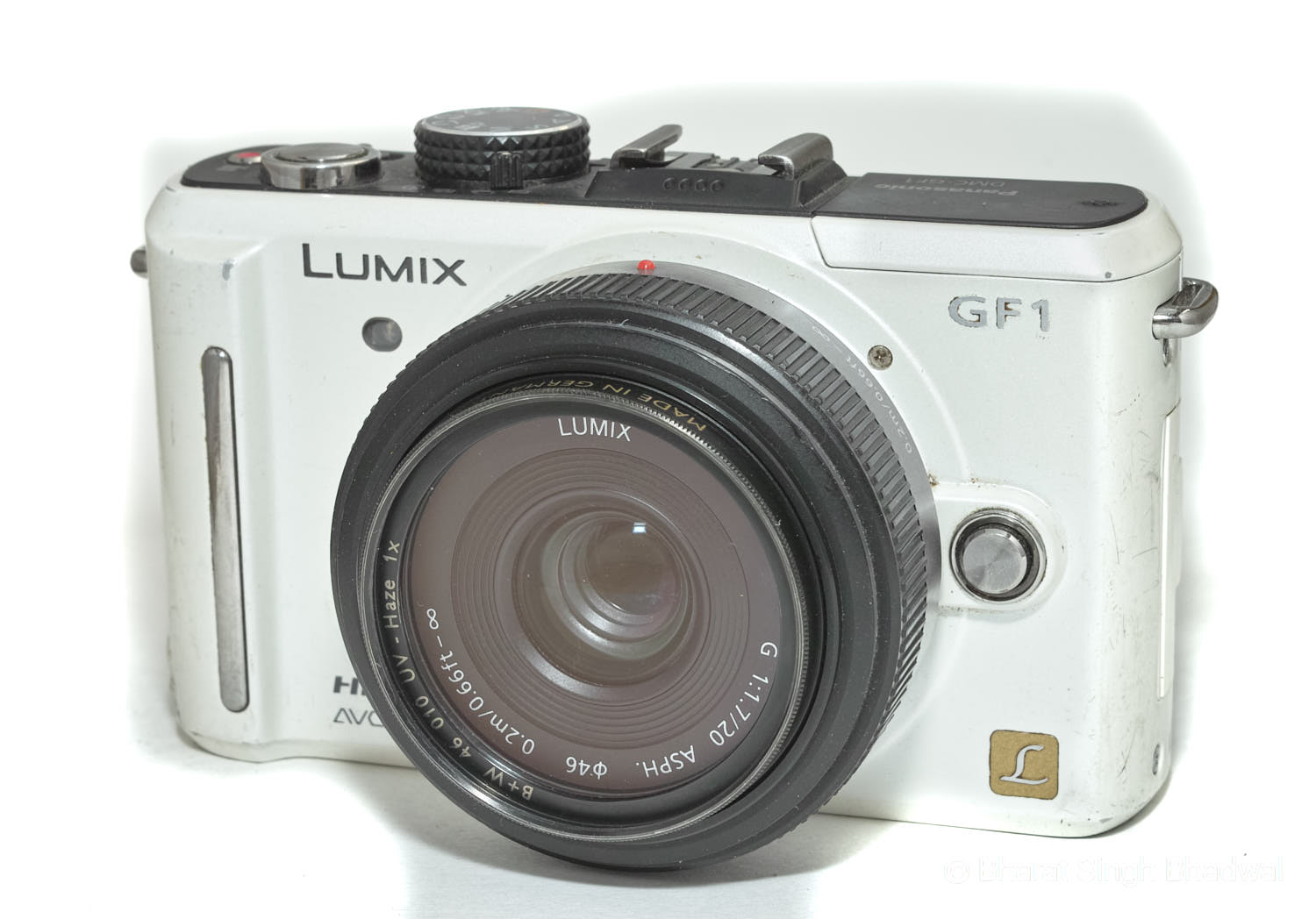 Our Panasonic GF1 with a broken battery lock door and cracked LCD. Still works perfectly though!