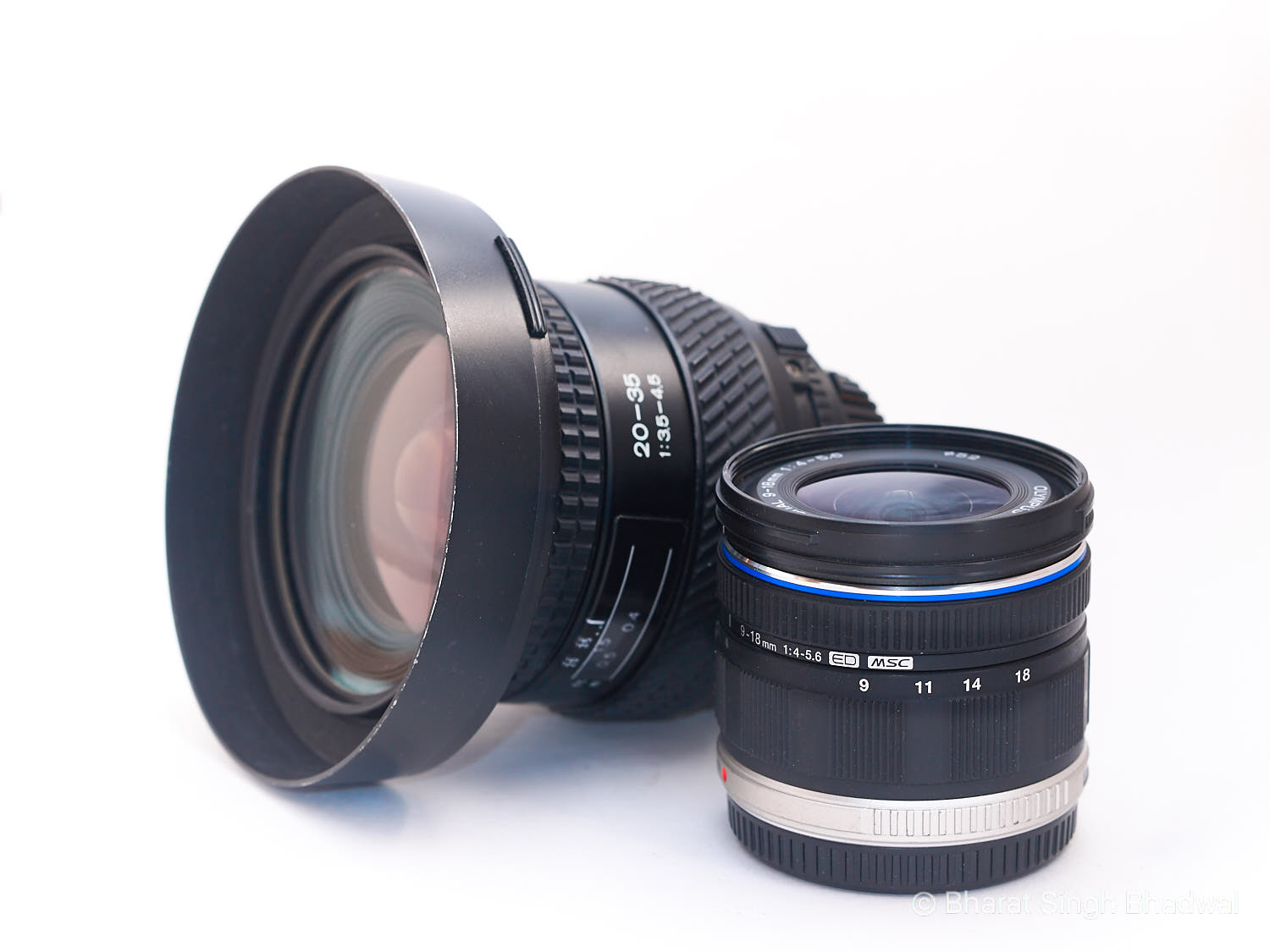 Size comparison between a full frame (20-35mm) wide angle lens and its equivalent micro4/3 lens (18-36mm) . The difference in size is startling.