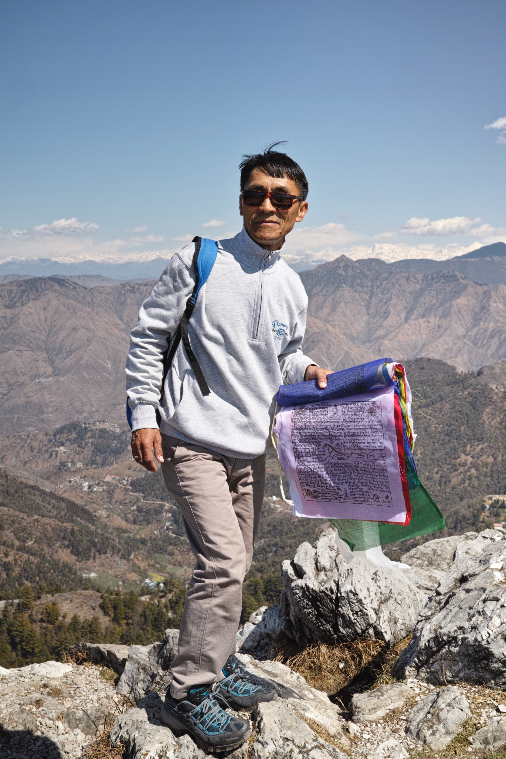 He had climbed the knoll to put up all new Tibetan prayer flags and he was not embarrassed to pose for me