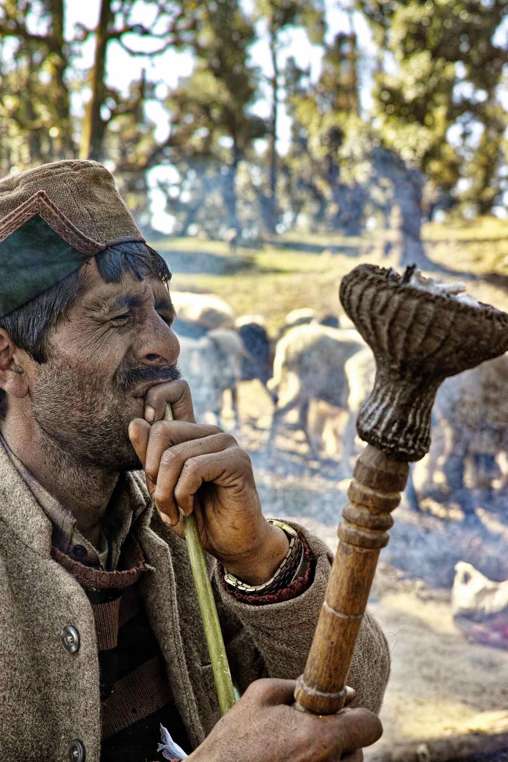 A Gaddi smoking a Hookah at Nag Tibba