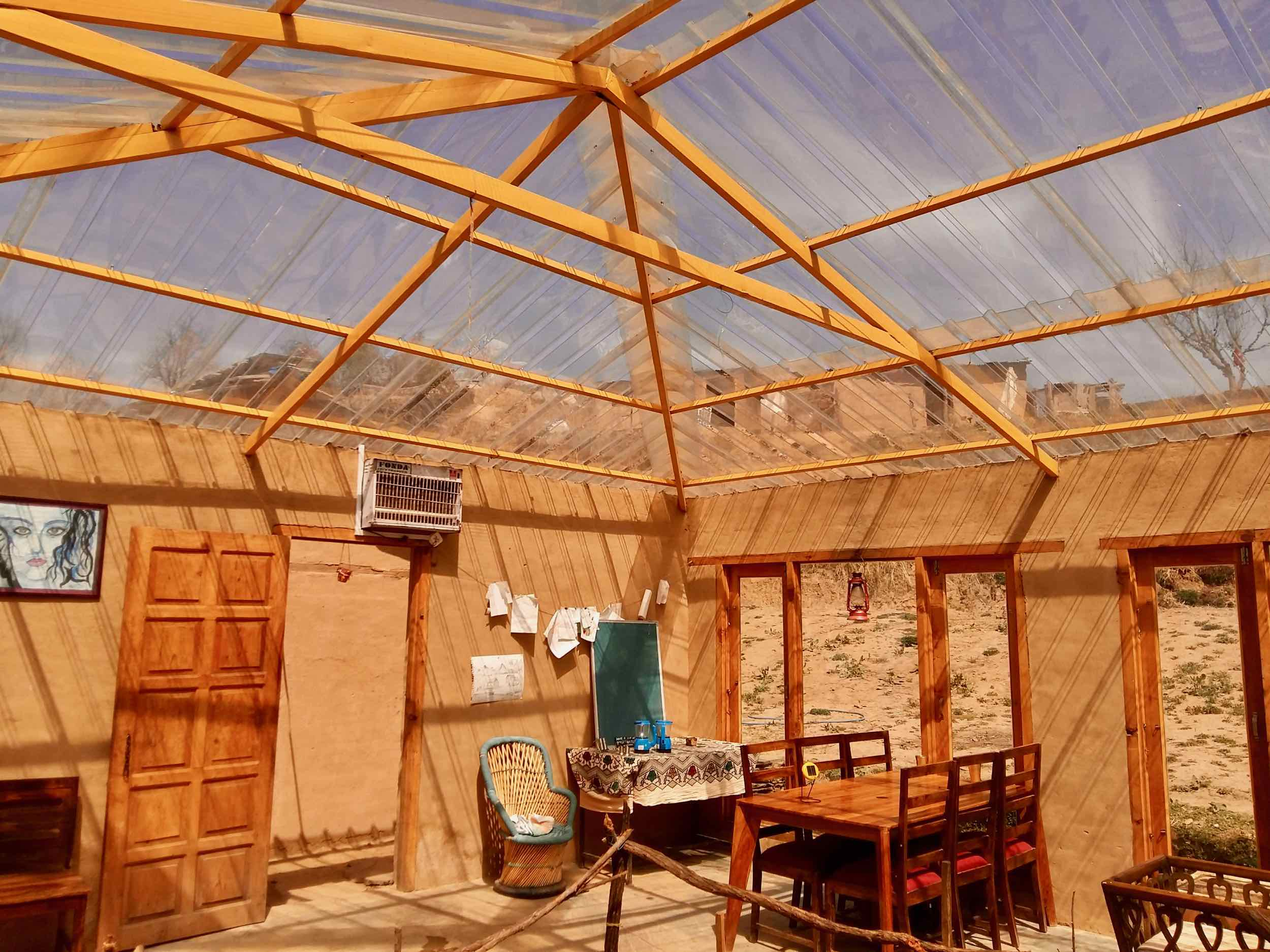 The rustic Goat Village resort's common room. We loved the transparent ceiling that acts as a glasshouse during the day and permits sky gazing during the night. Note the rustic setting.