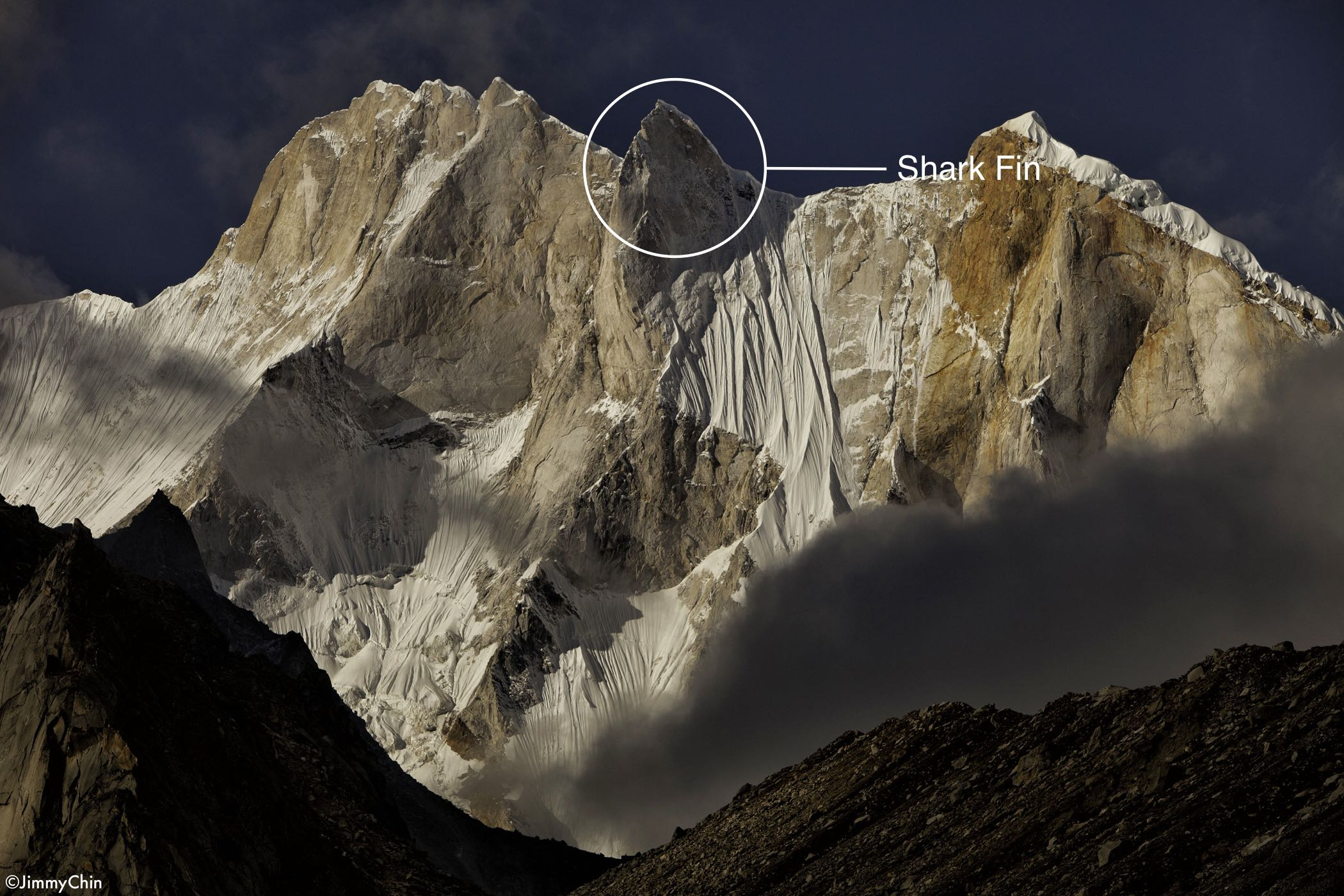 This is a view of Mount Meru as seen from Tapovon Basecamp. The Shark's Fin is the central pillar in the formation and the part of the mountain most obviously shaped like a Shark's Fin. © Jimmy Chin from http://www.merufilm.com/