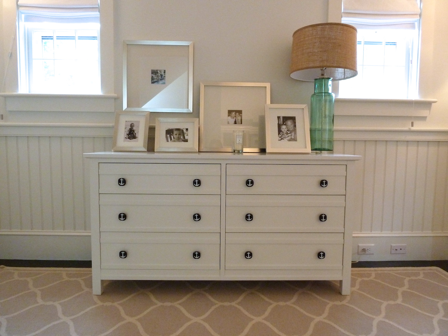 White dresser with navy anchor knobs