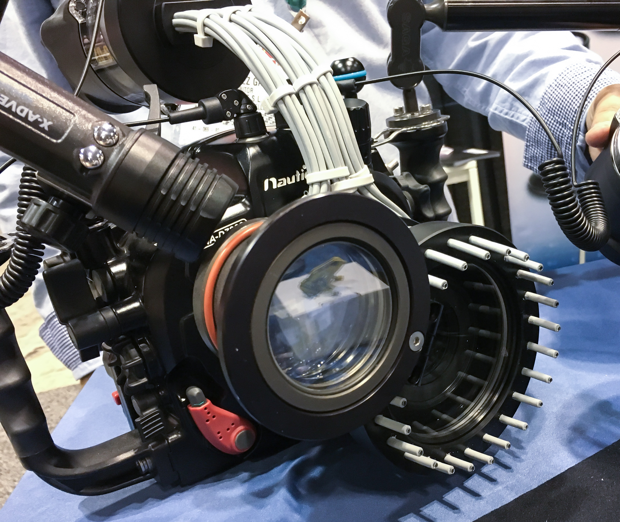 The Saga Dive ring flash system can be disengaged and slid back, and also is compatible with a wet diopter, which can be flipped out of the way if desired