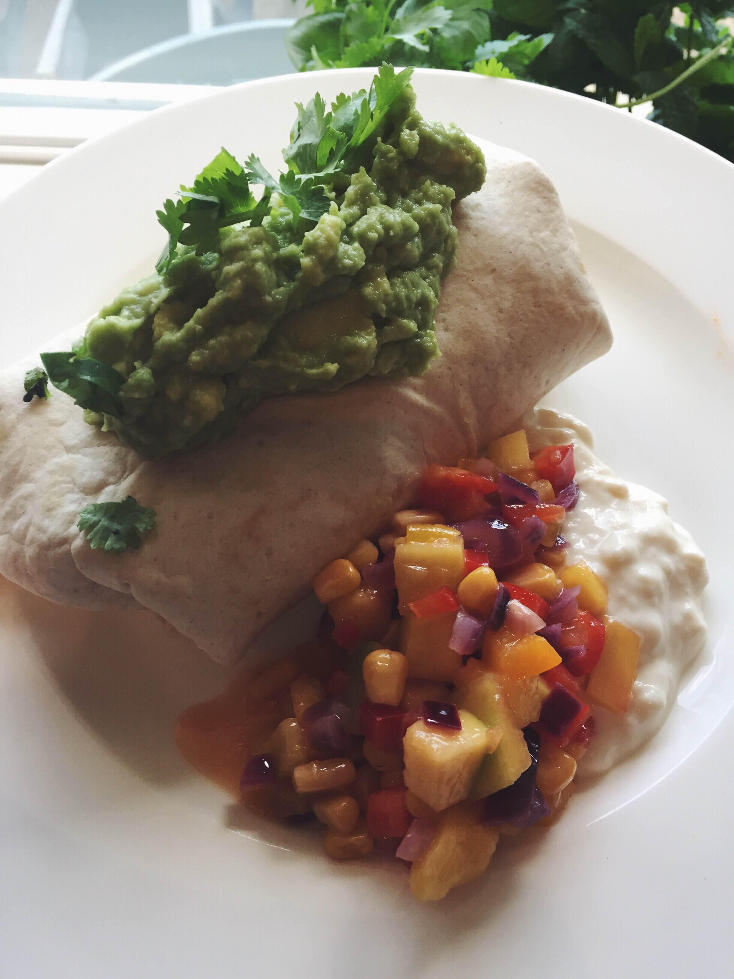 Sweet potato chilli burritos with mango, sweetcorn and red onion salsa, almond yoghurt and   lotsa   guac