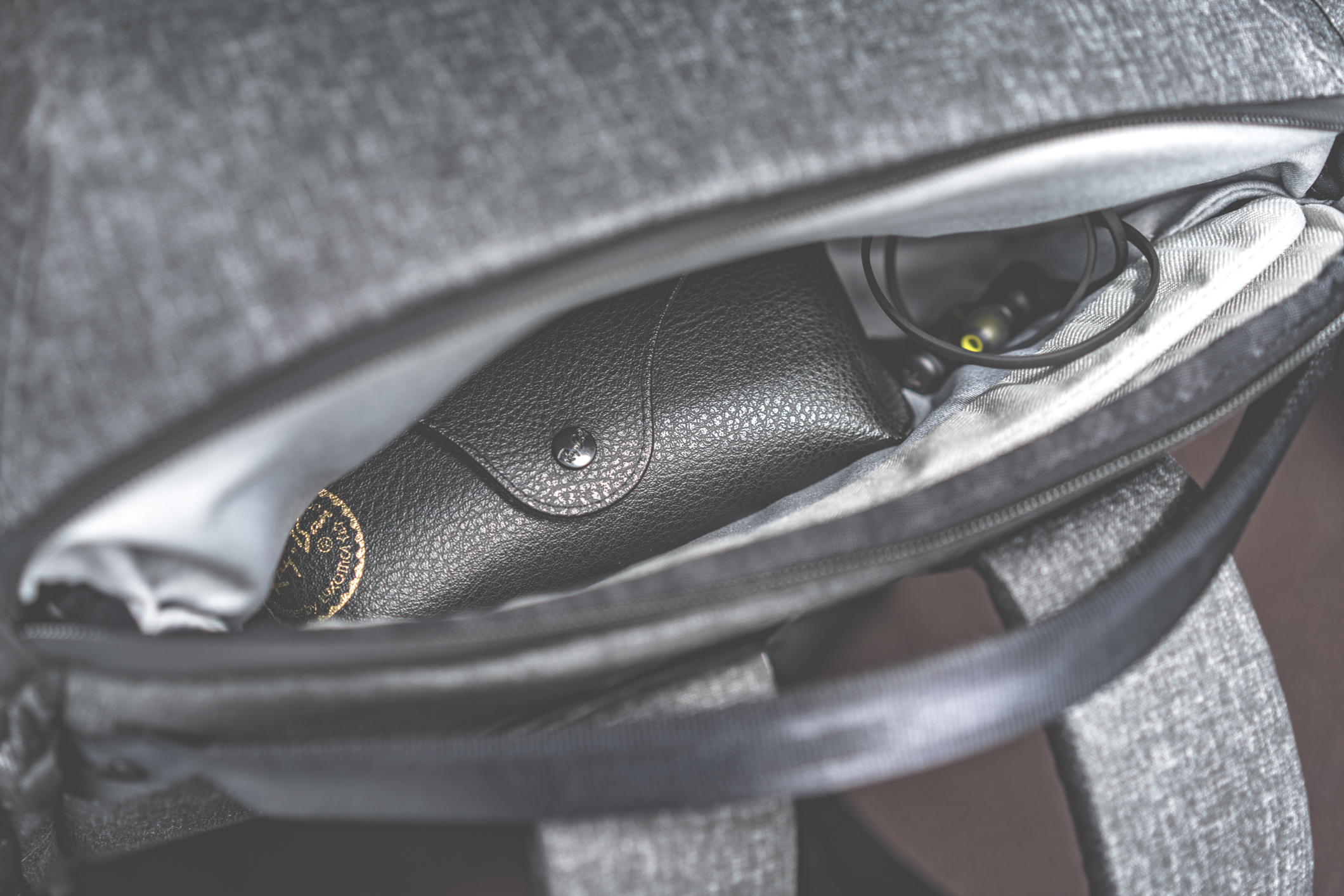Hidden pouch in the laptop access zipper for small items.