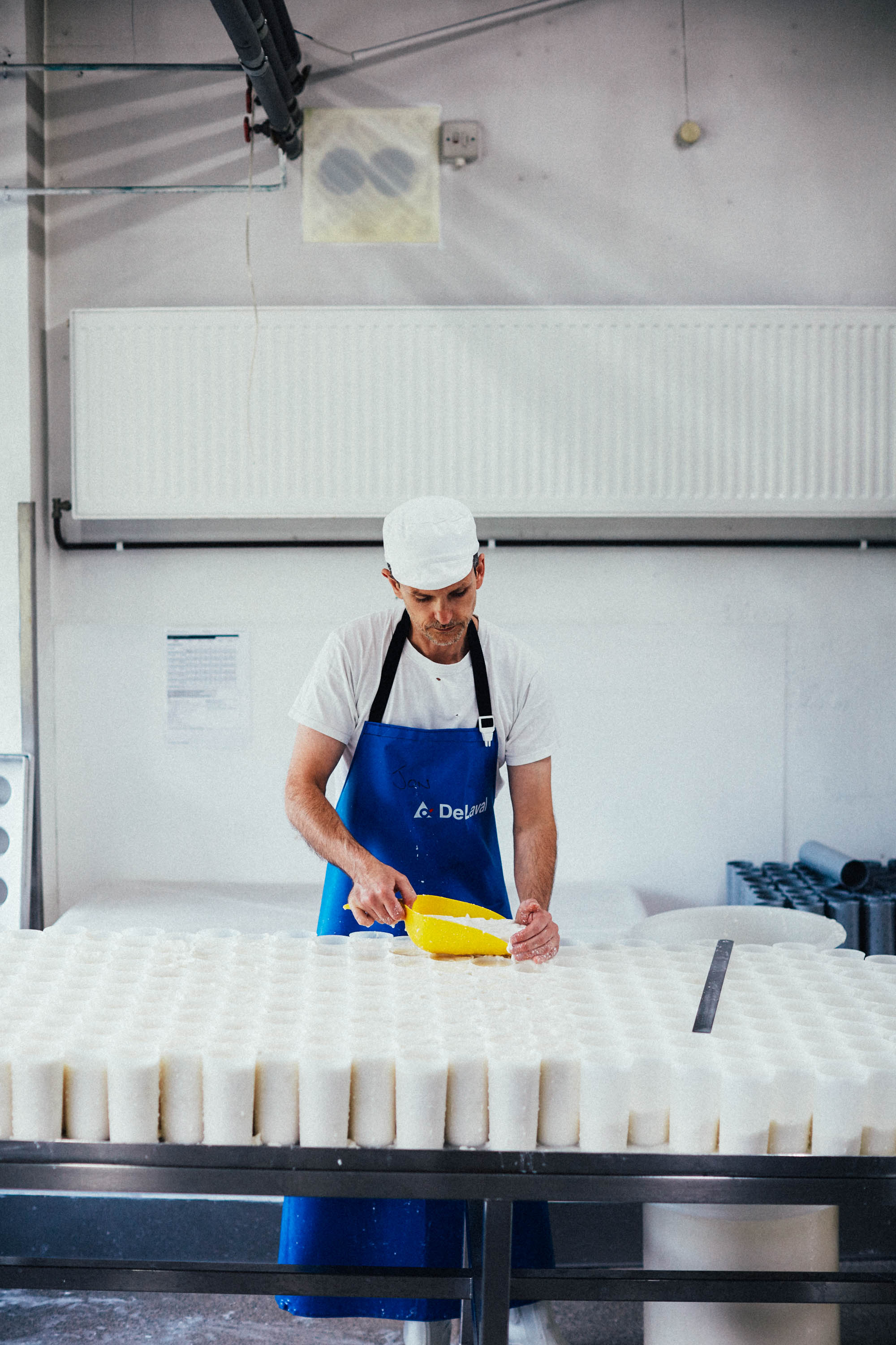 Jon Fills moulds to strain off whey for their Ragstone - a fresh goats cheese.