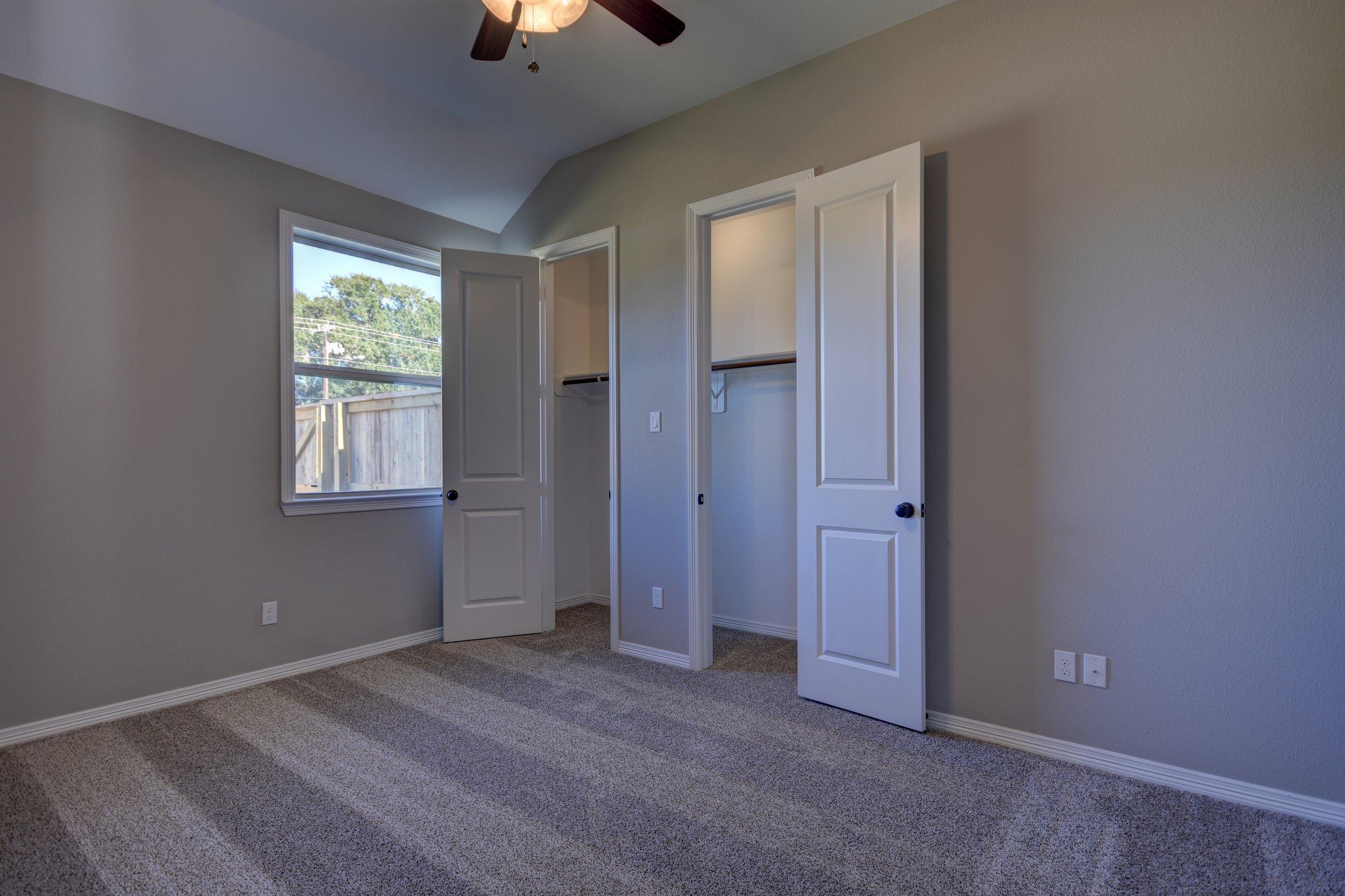 Bedroom 2 A - Closets Open.jpg