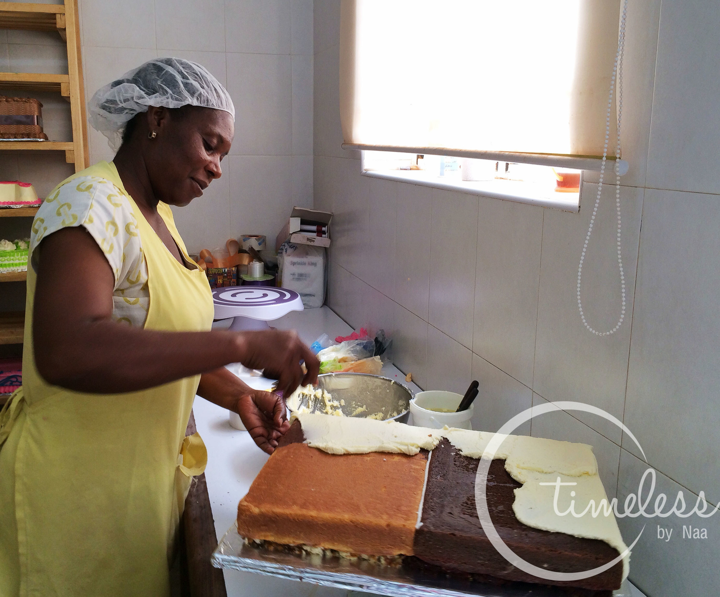 Baker decorating cake with icing