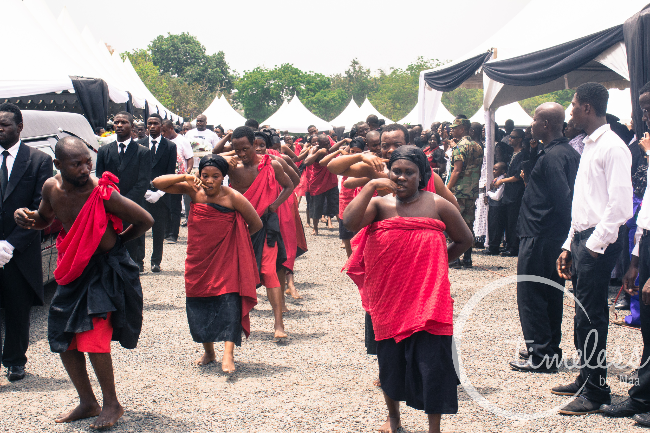 Traditional dancers gesturing to show the deep pain of Komla's demise.