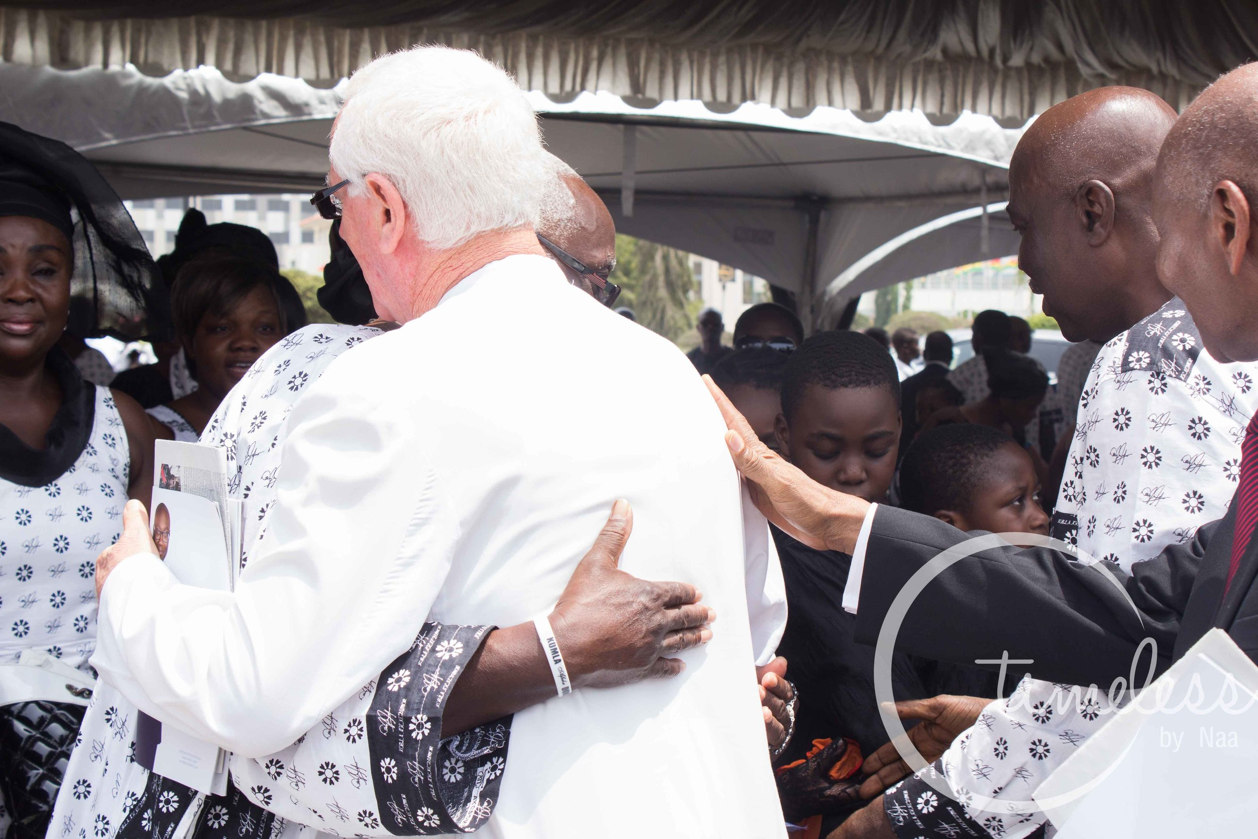 Father Campbell consoling Professor Dumor