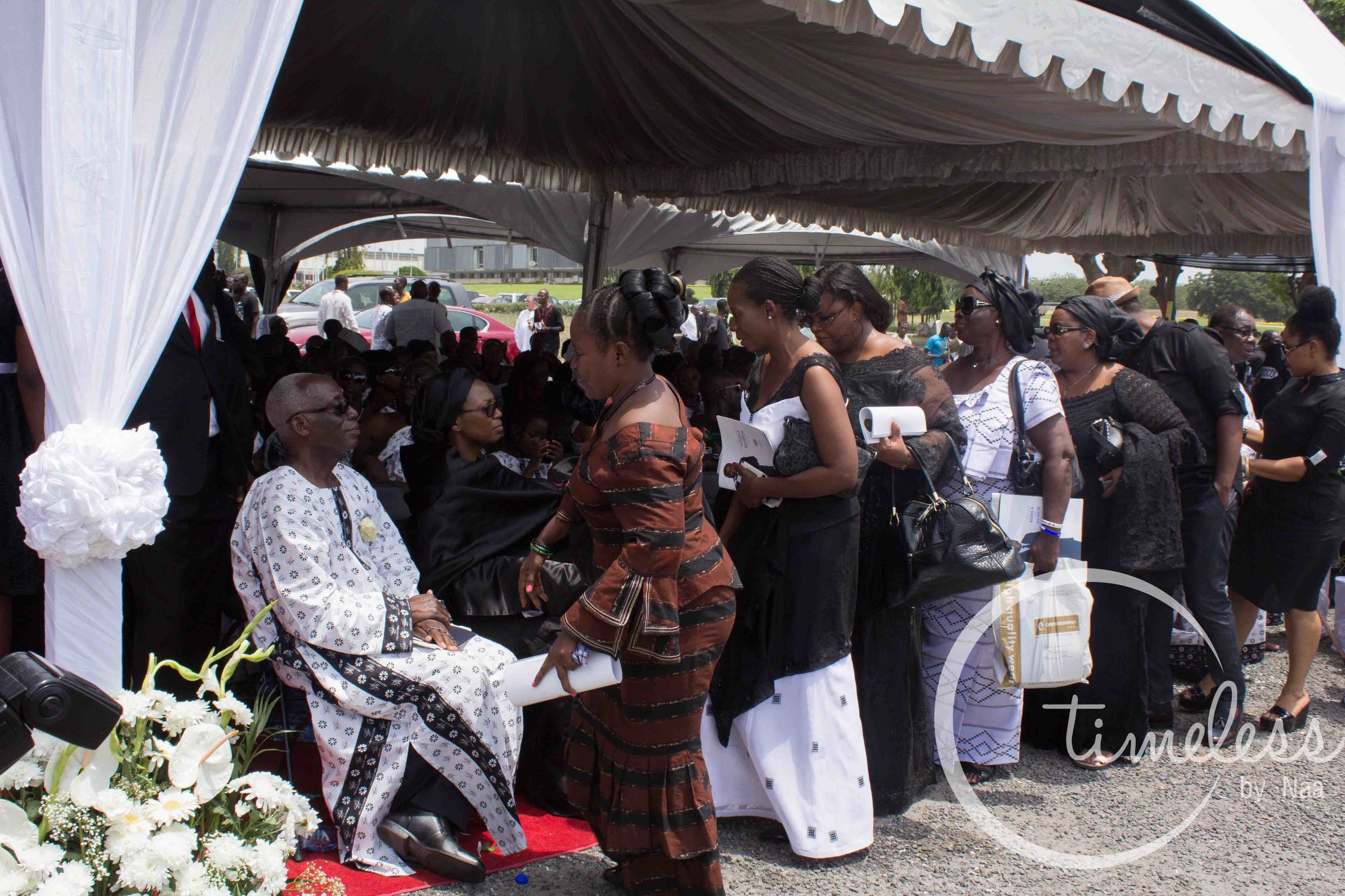 Mourners queue to pay their respects to the family.