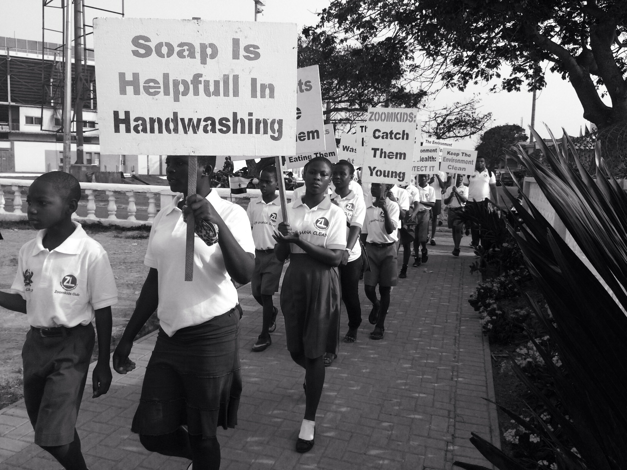 ZoomLion Kids with placards on health and environmental issues
