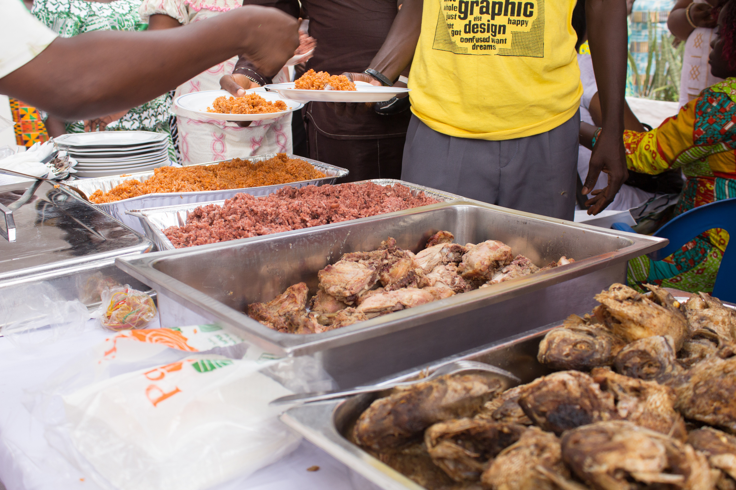 An array of Ghanaian food at a traditional engagement party.