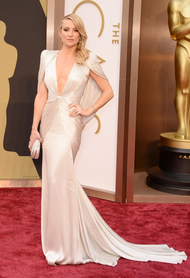 Kate Hudson looked stunning in this neck plunging, beaded, satin gown. The dress just fits her to the T!