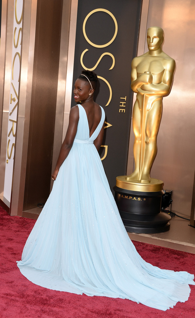 Lupita Nyong'o was glowing in this baby blue Prada gown and finishes the look with a gold and diamond headband.