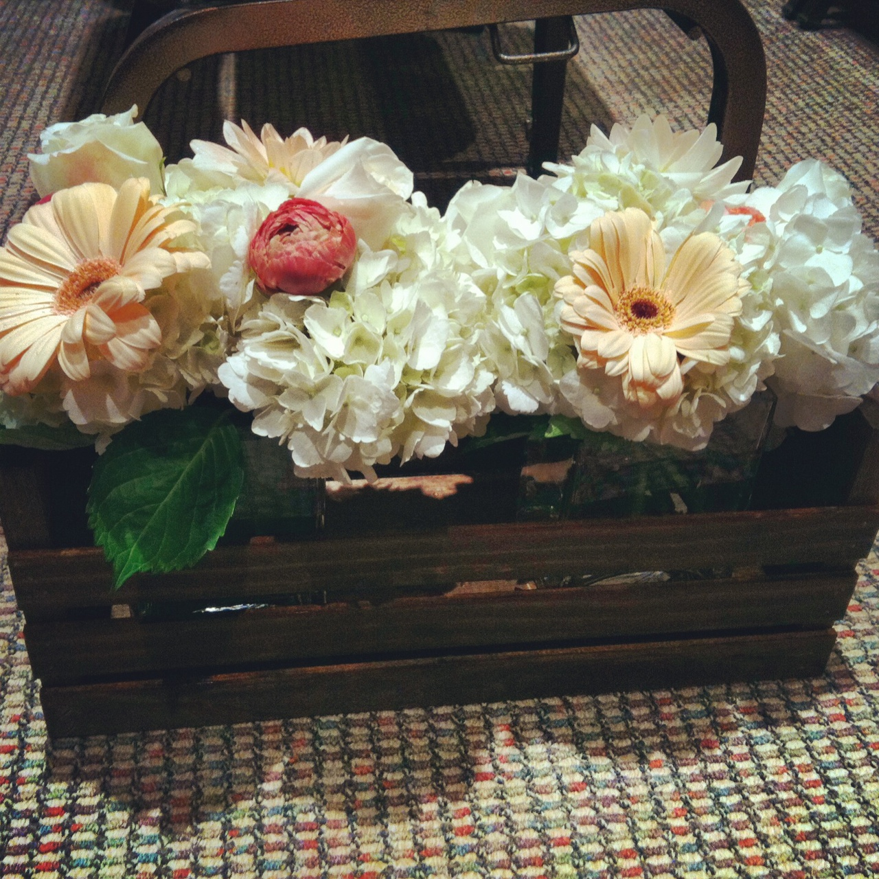 Fun fact: The mother of the bride hand made 20 of these gorgeous flower crates.