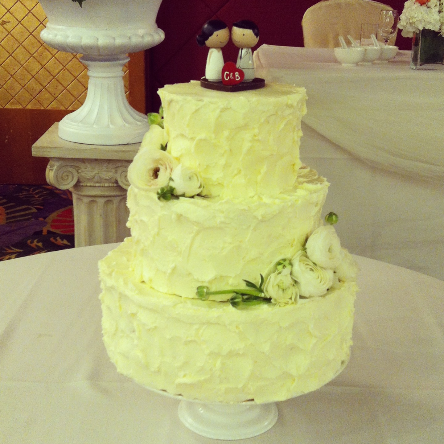 Ivory ranunculus give this cake a fresh look. Check out the cute cake topper! Cake made by Melissa Wong