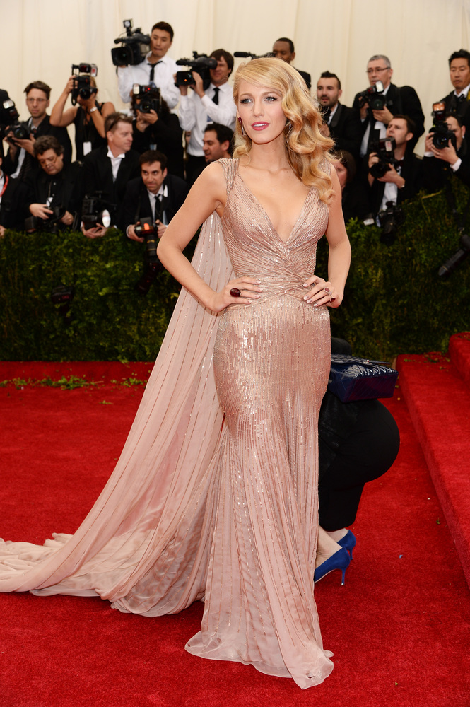 Blake Lively shows off her curves in a sequined nude Gucci dress.