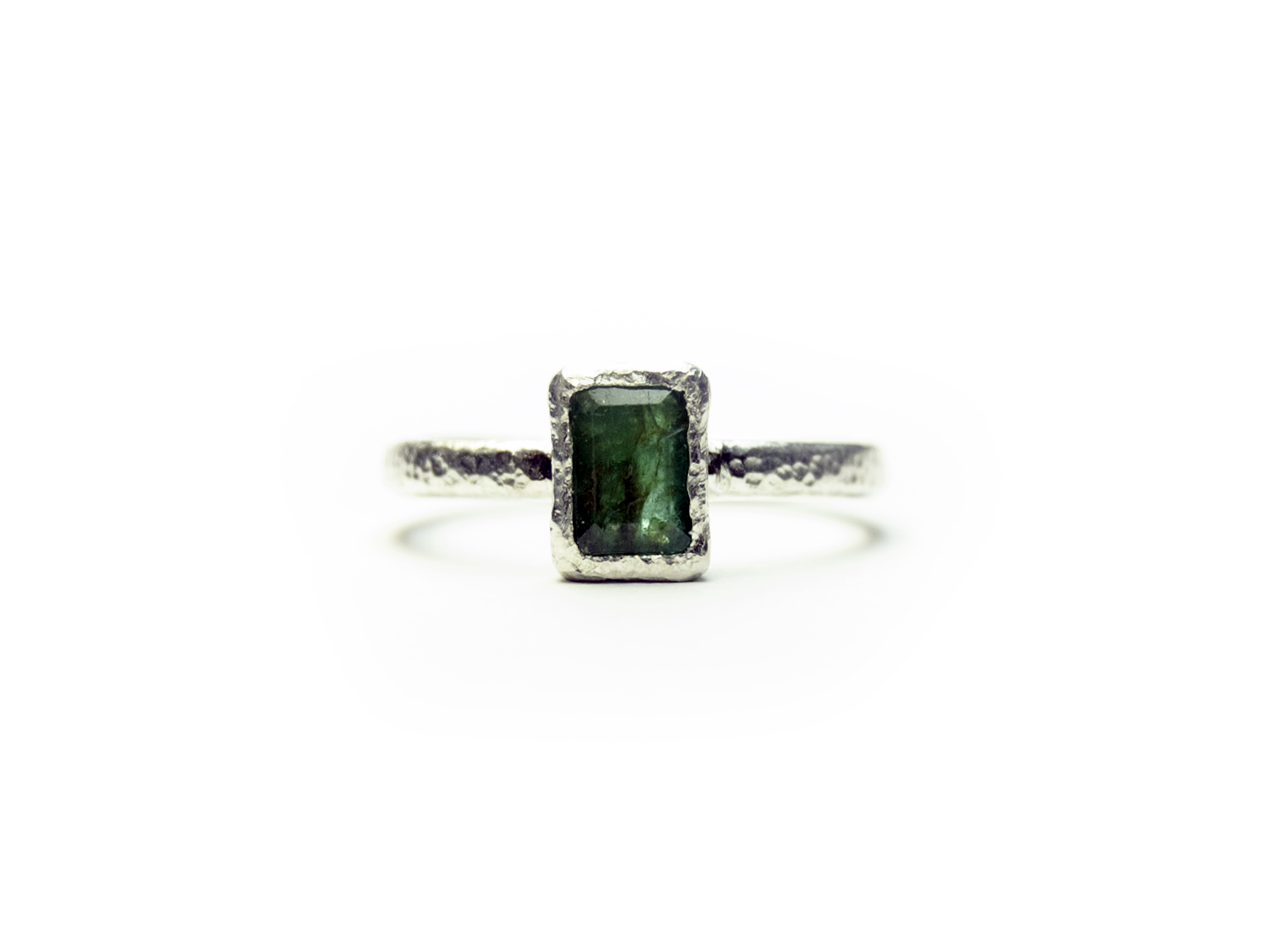 100% recycled sterling silver featuring an emerald cut natural emerald.