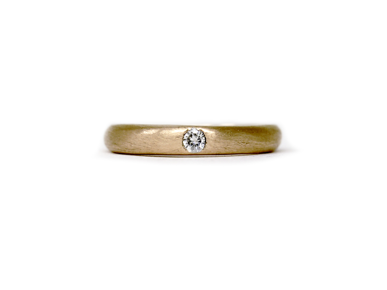 Rose gold understated engagement ring featuring an ethical Moissanite stone