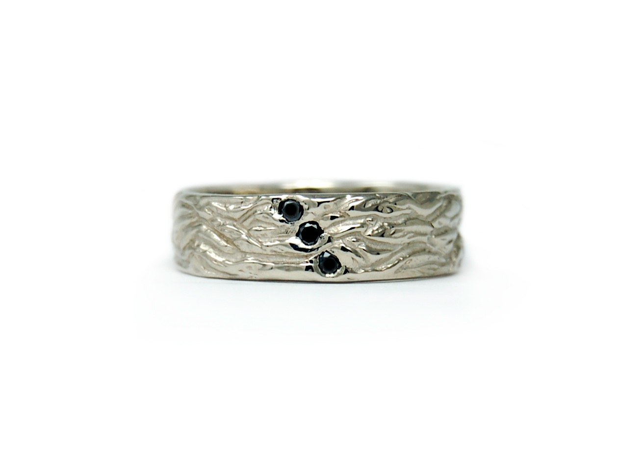 Custom Texture - I can always create a completely one of a kind texture for your ring! Paired here with three black diamonds