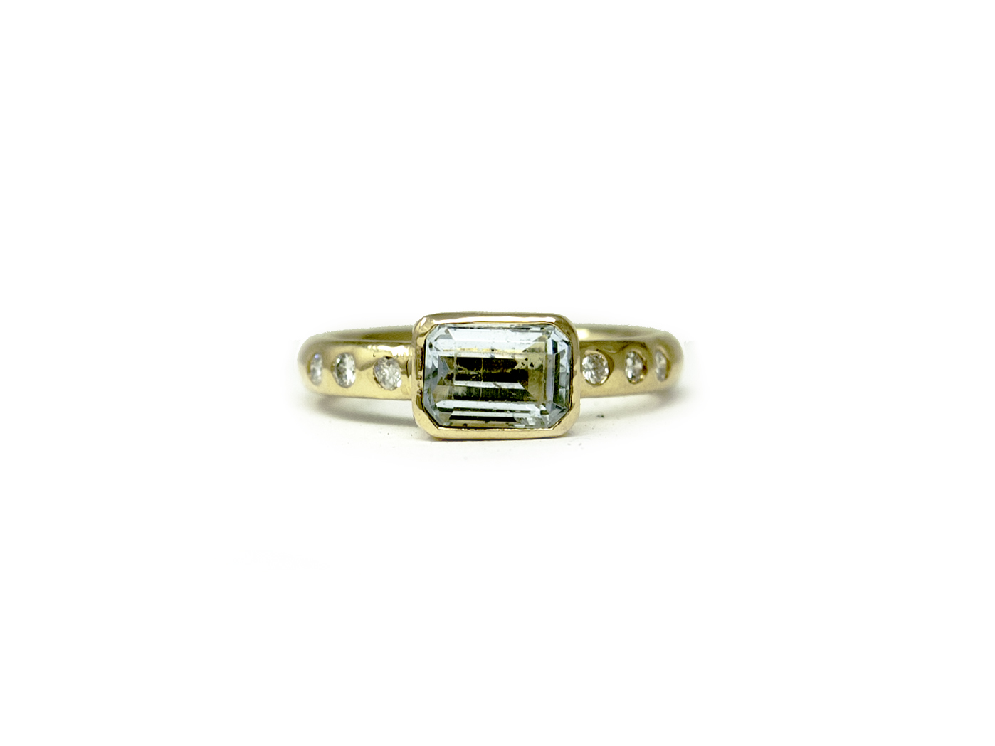 18kt gold houses this special heirloom aquamarine and white diamonds for Brittany's mother's day gift.