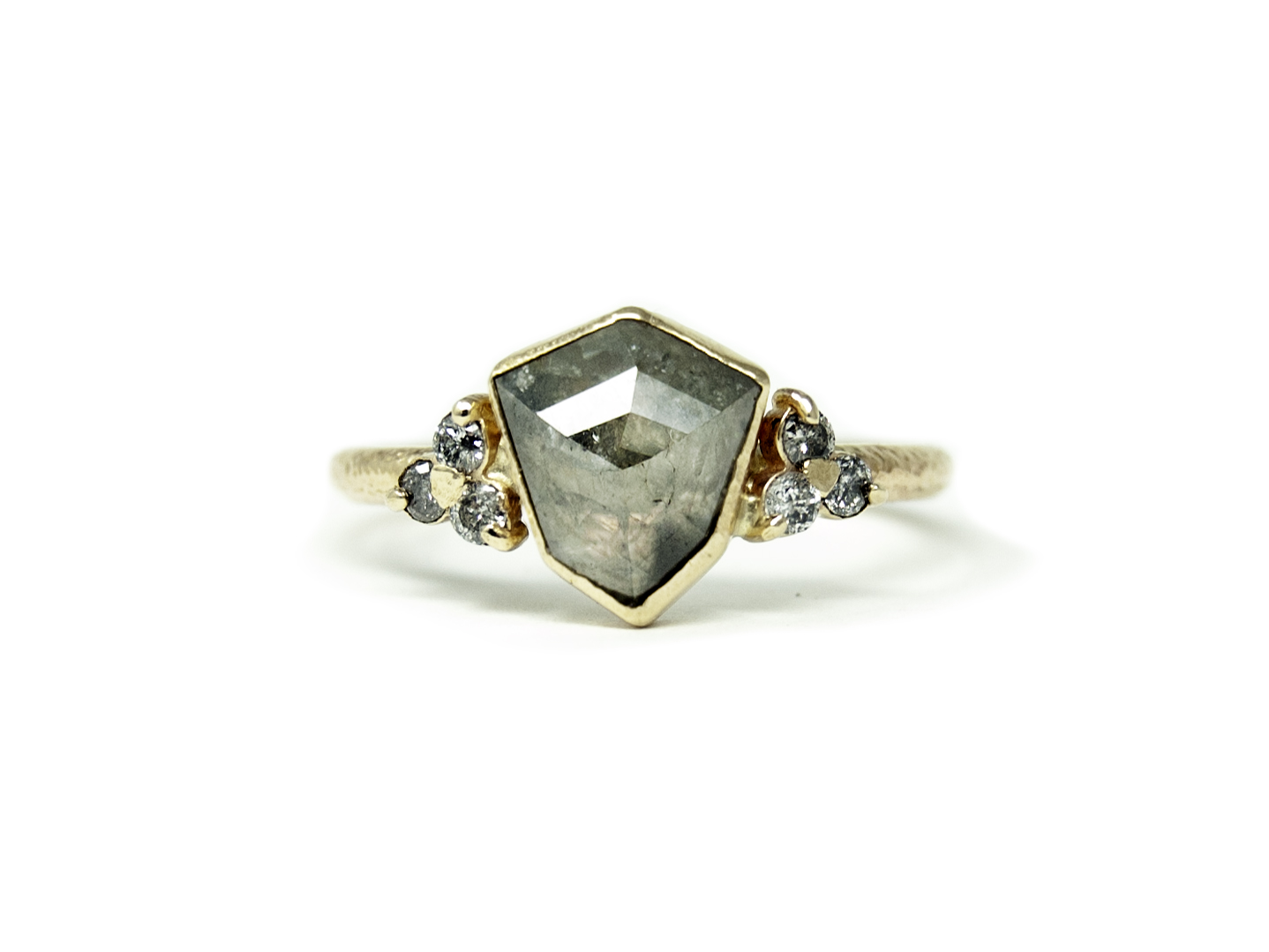 Love the unique shield shaped diamond in this engagement ring.