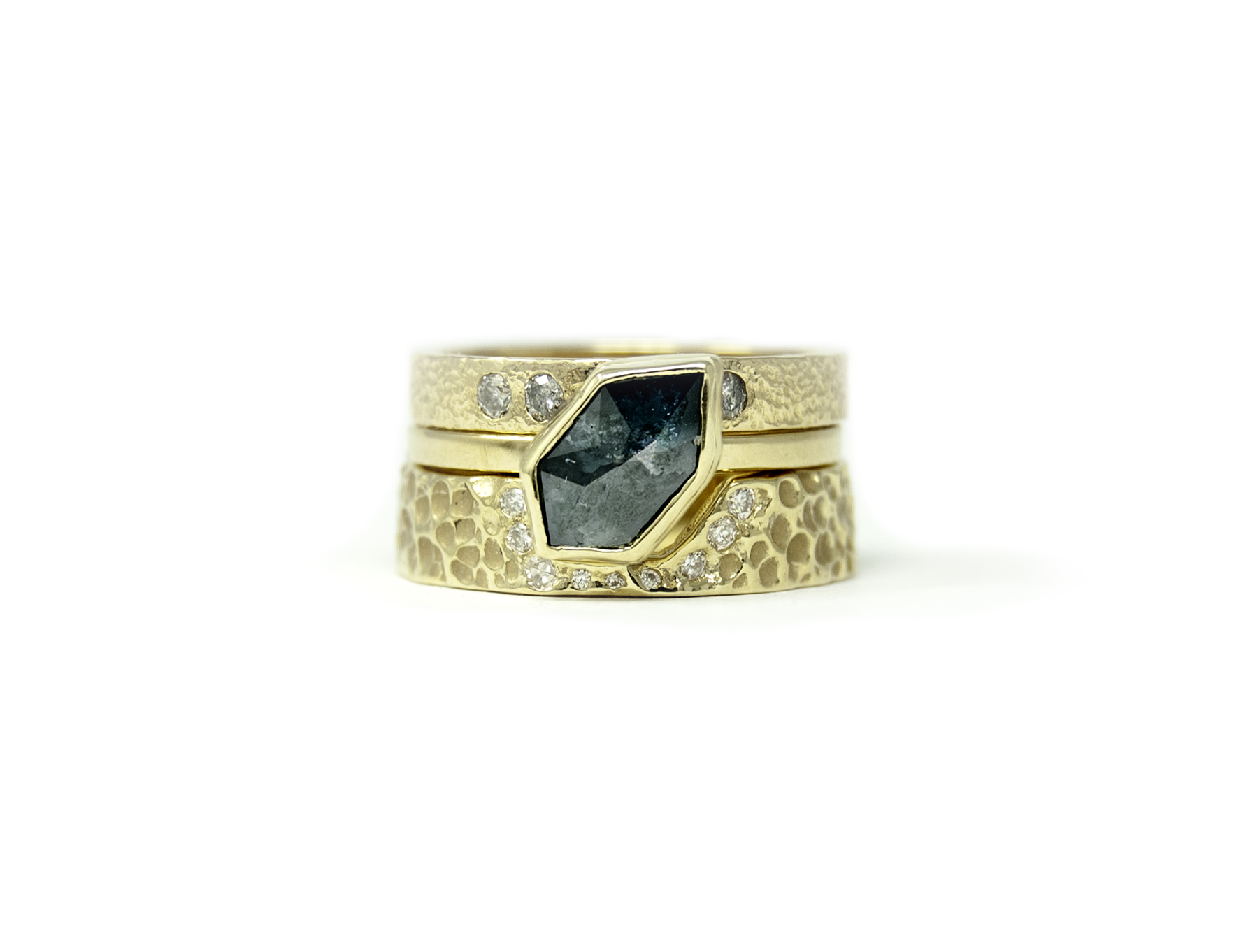 Two wedding bands is 2019's hottest trend- and we are not complaining about it in this recent wedding set featuring a blue diamond!