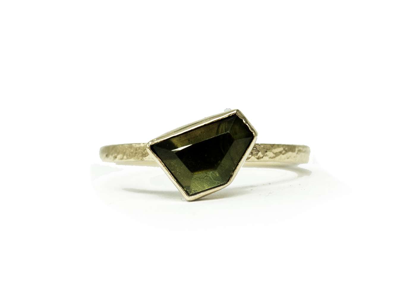 A gift to herself just because- Tiffany picked our favorite geometric cut sapphire for this yellow gold beauty.