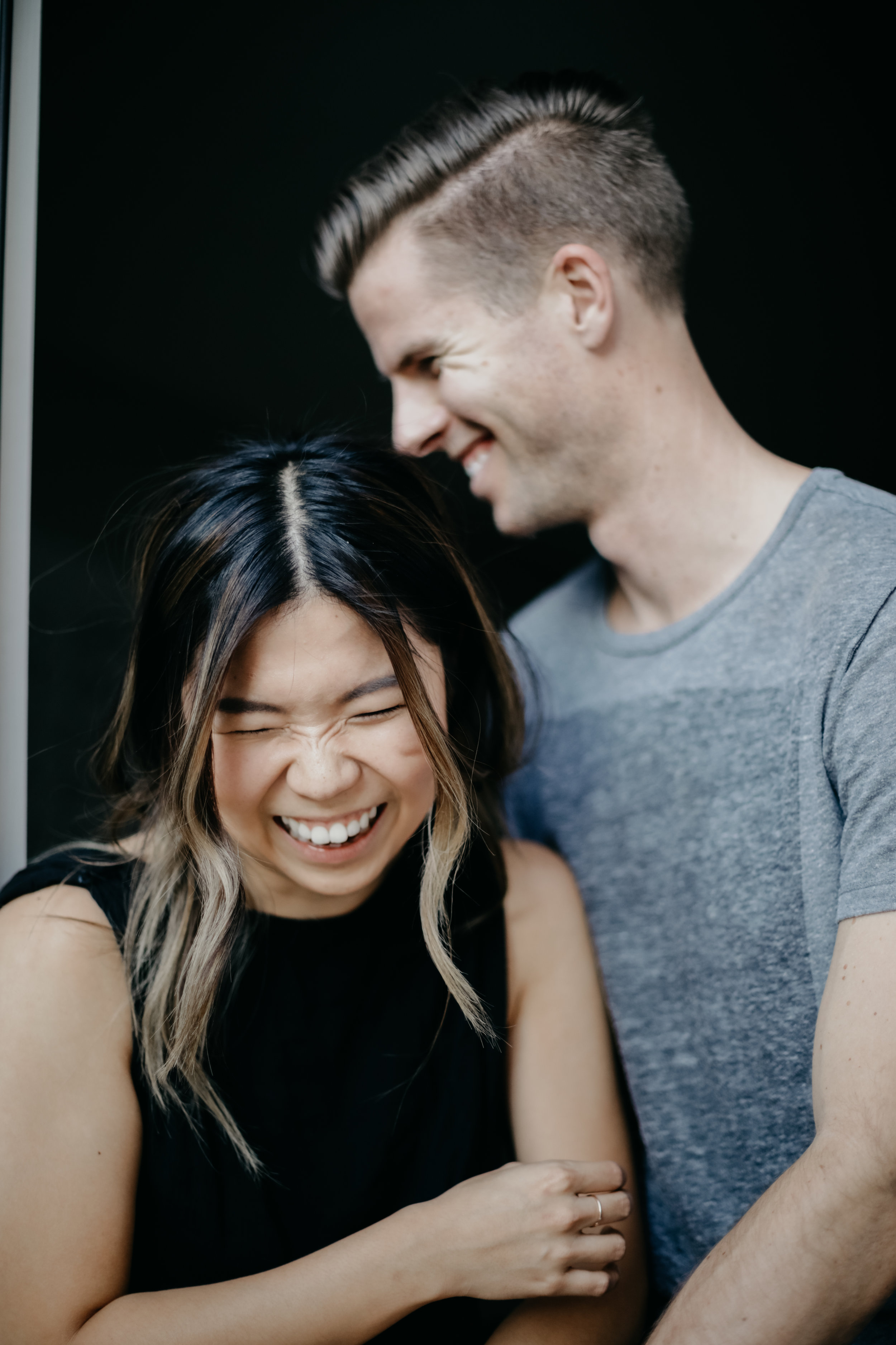couple shot laughing