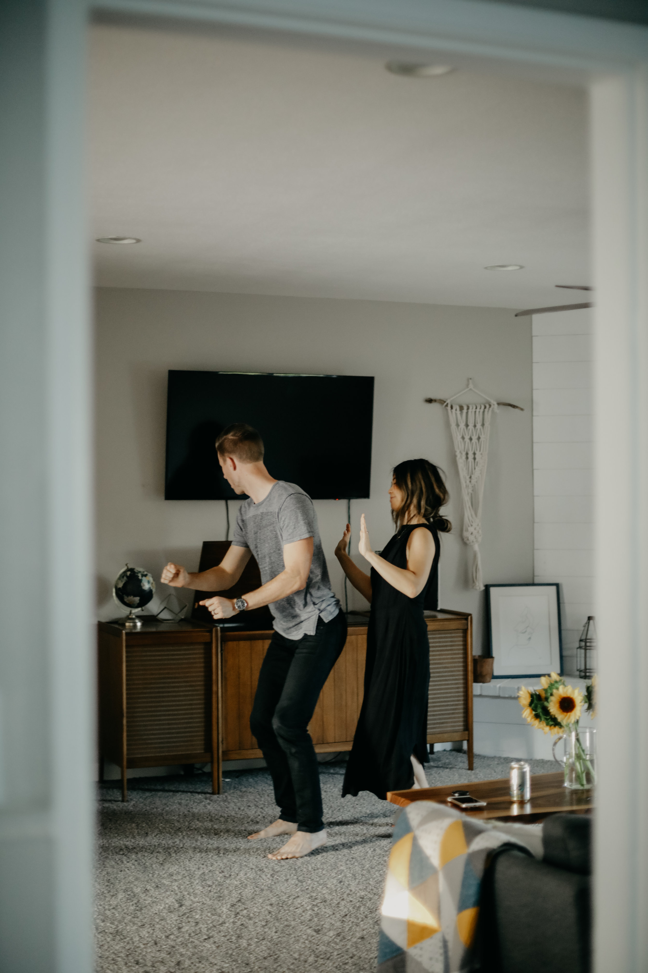 silly couple dancing in living room