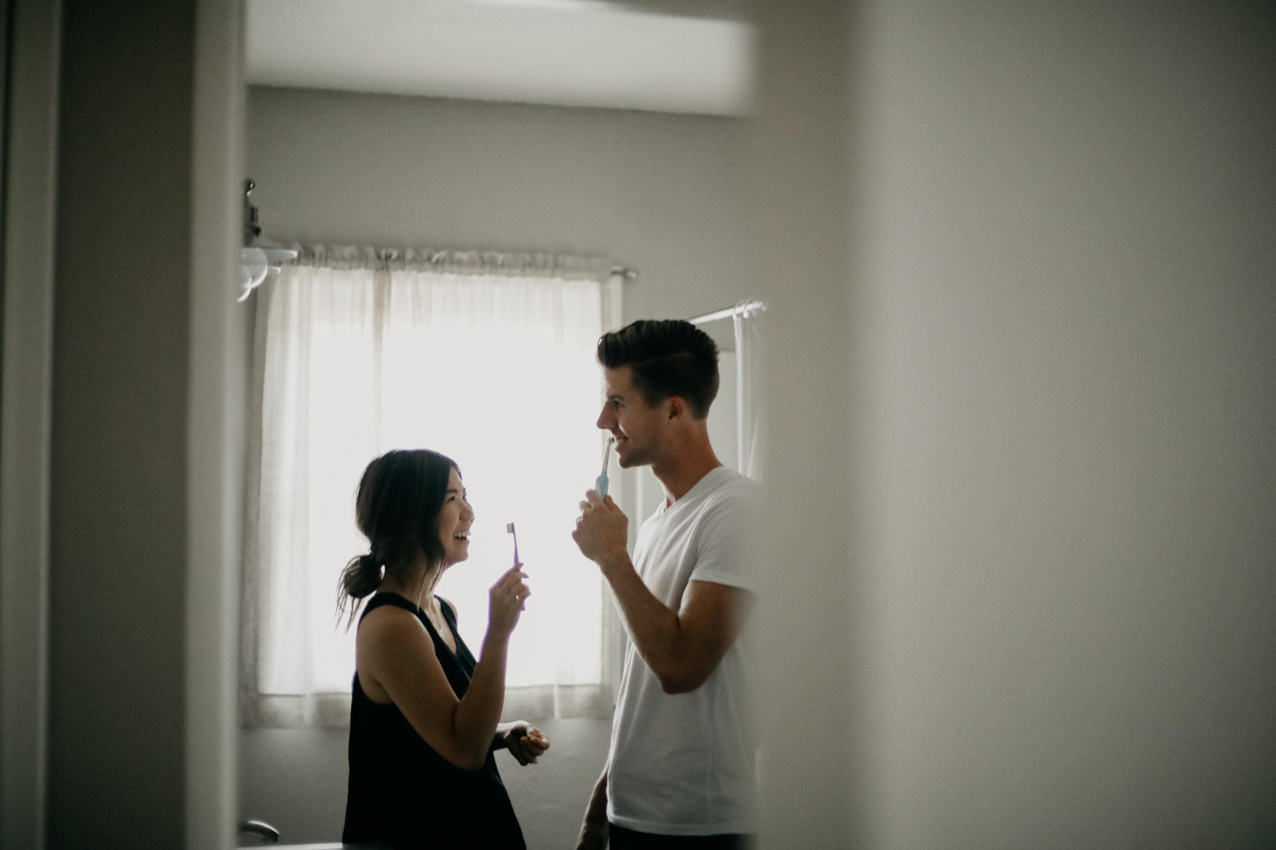 couple brushing teeth home shoot