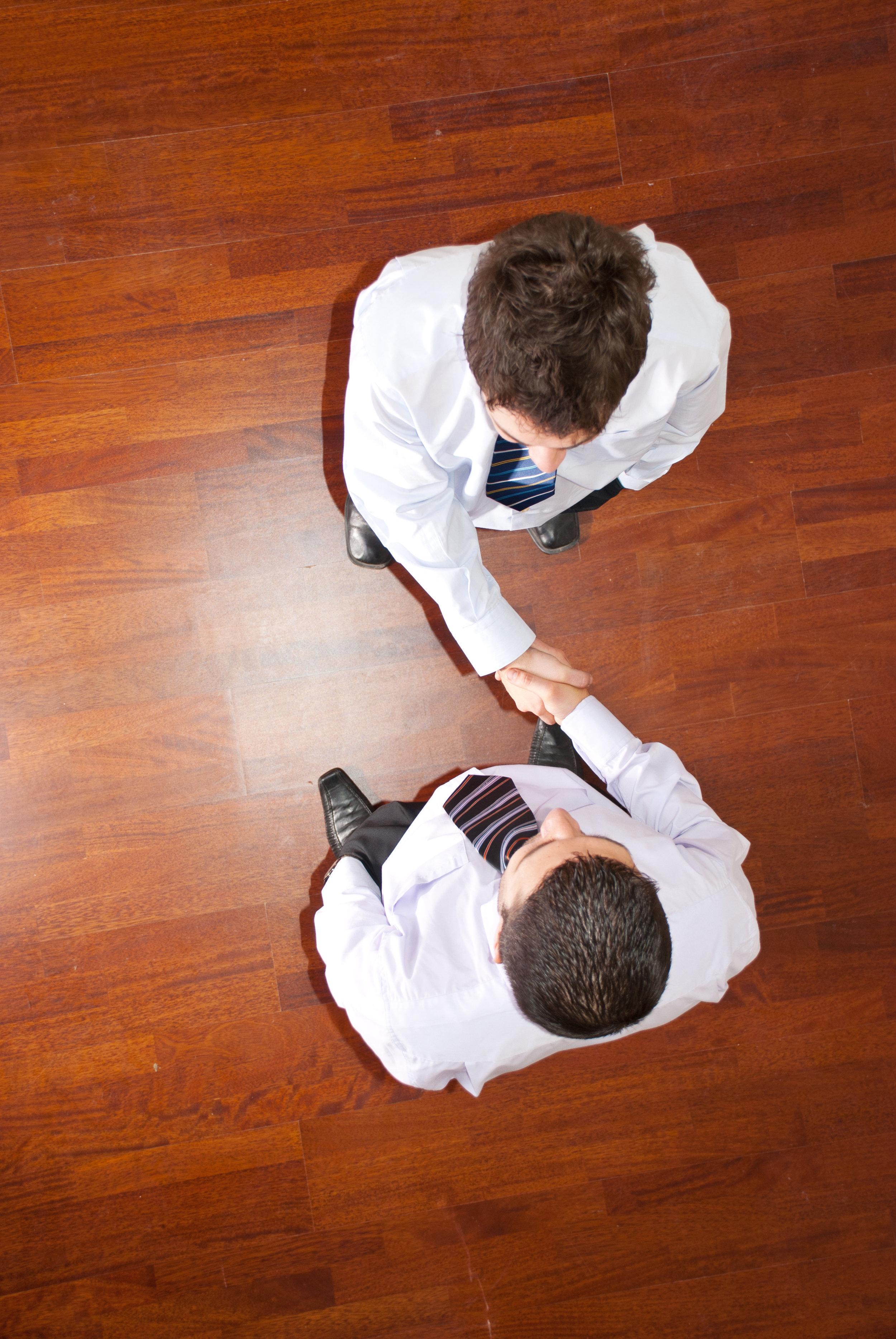 AdobeStock_30143254 handshake above.jpeg