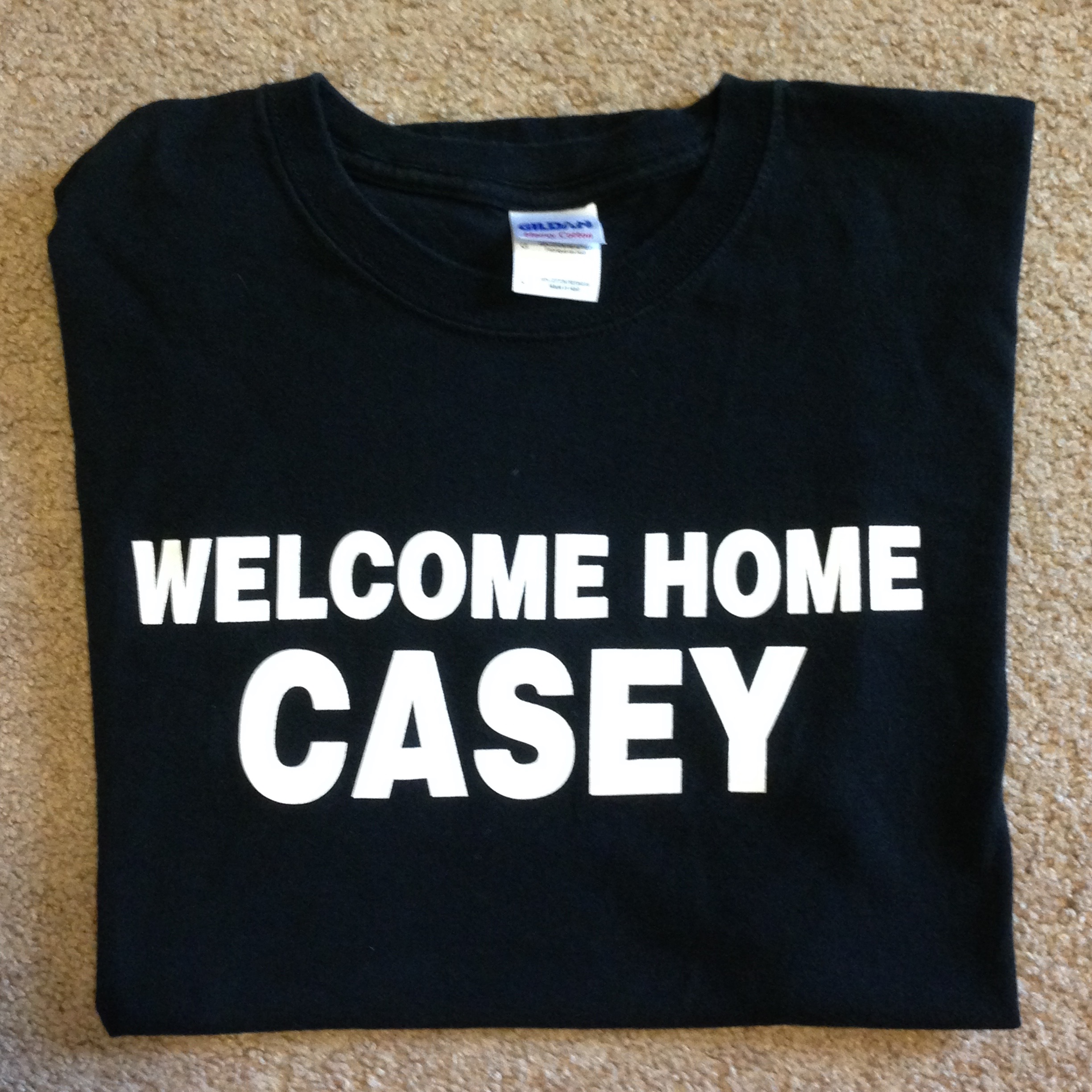 Who is Casey? Is that a girl or a guy? Where is home, and who is welcoming Casey there? Why is the shirt so simple and austere?