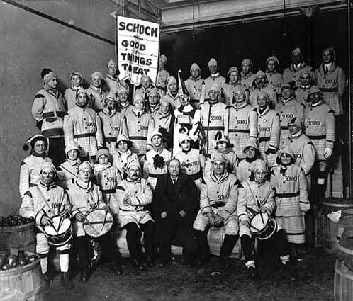 1916 Andrew Schoch Grocery Company Winter Carnival marching unit in store, Lowertown.jpg