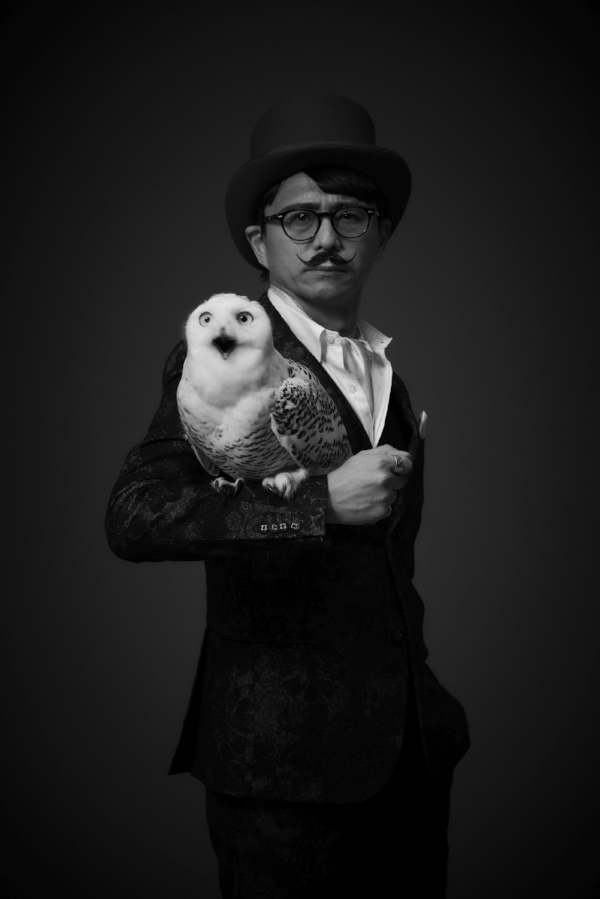 LOOK AT HIM. HE HAS AN OWL!