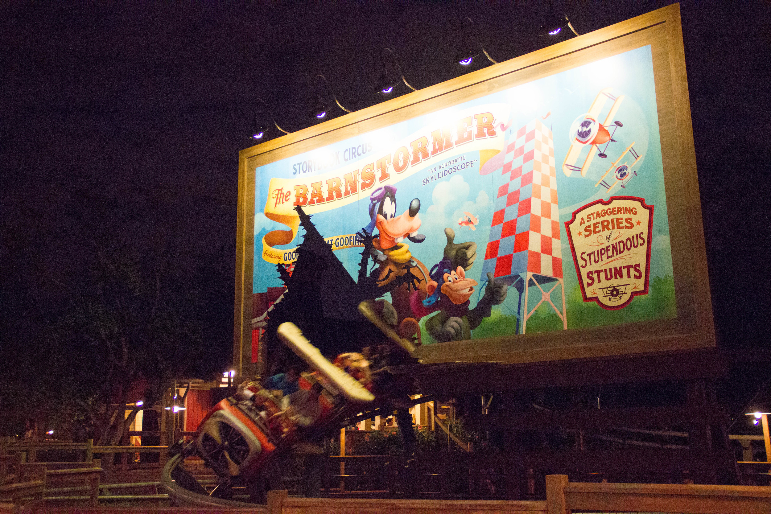 I love the idea of the coaster busting through the billboard