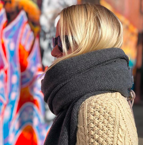 The model is the designer is the model is the designer. And she'll teach you the proper way to tie a scarf.  Hint: we've all been doing it wrong.