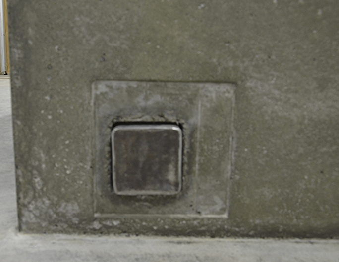 Steel footrail penetrating concrete